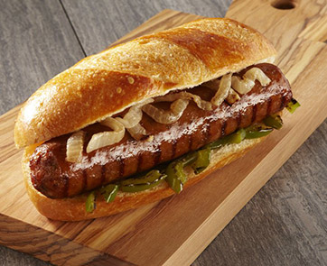 Johnsonville Foodservice authentic Italian Sausage served on a bun with grilled peppers and onions
