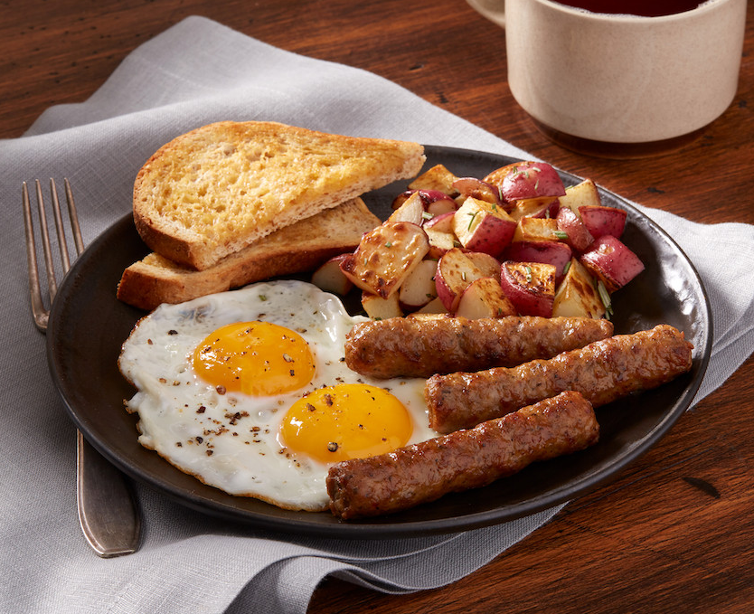 plate of Johnsonville Foodservice Original Breakfast Sausage Links with toast, fried eggs, and potatoes